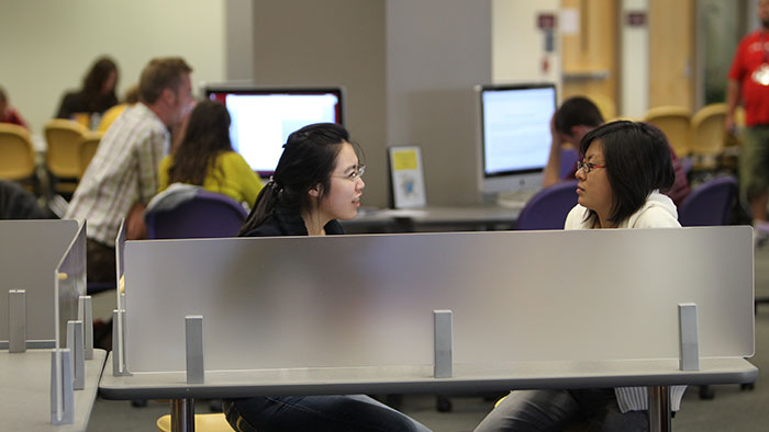 Students at work in the Bear CLAW, including a tutoring session