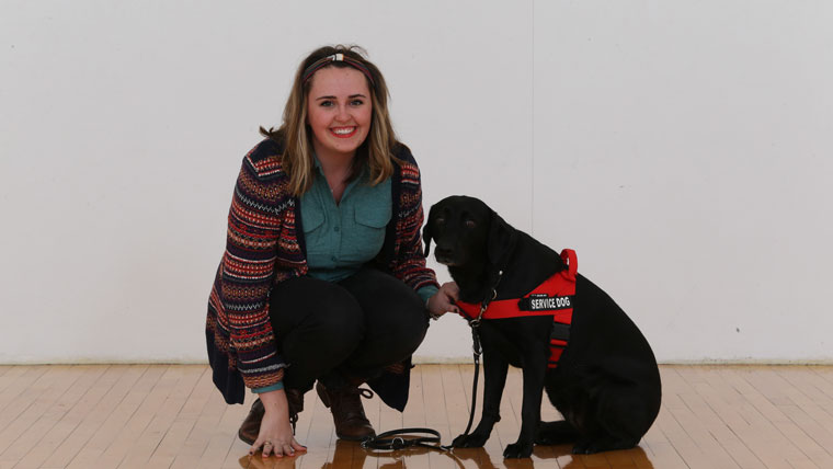 Student with service dog.