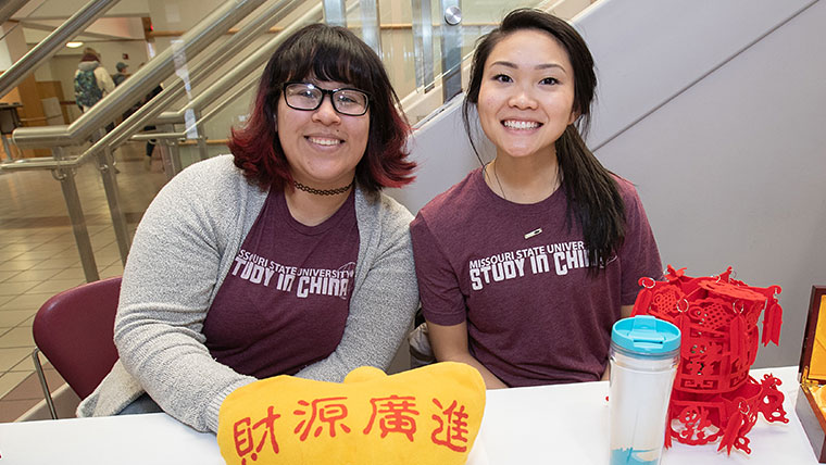 Two Missouri State students sitting at a table to answer questions about study in China.