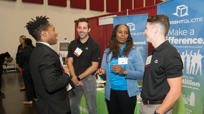 Student talking with prospective employers