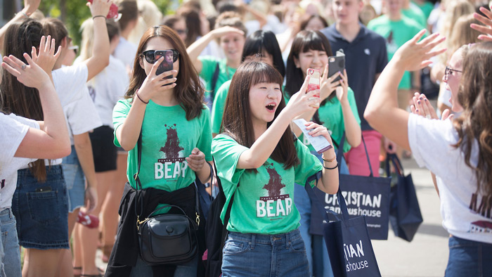 Students take photos while walking through Bear Path