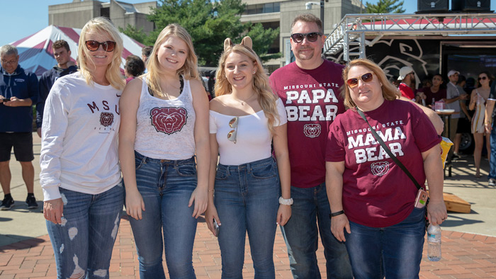 A family poses for a photo in Missouri State shirts.