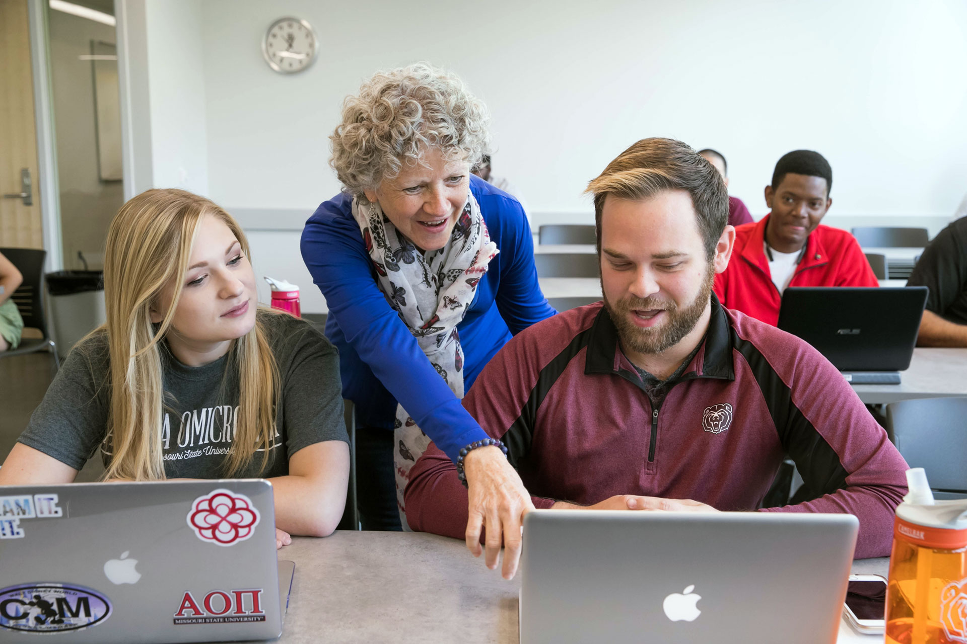 MSU instructor helping student