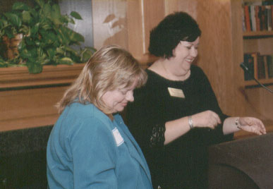 Sandy Culver is recognized by Kathy Davis for her 2005 MACADA Outstanding Advising Award