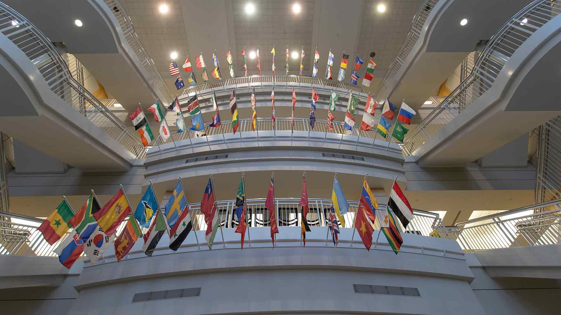 International flags displayed in Strong Hall.