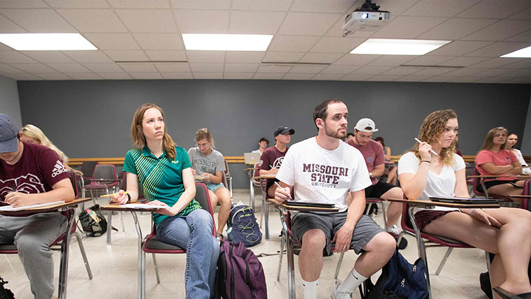 Kinesiology students seated in class.