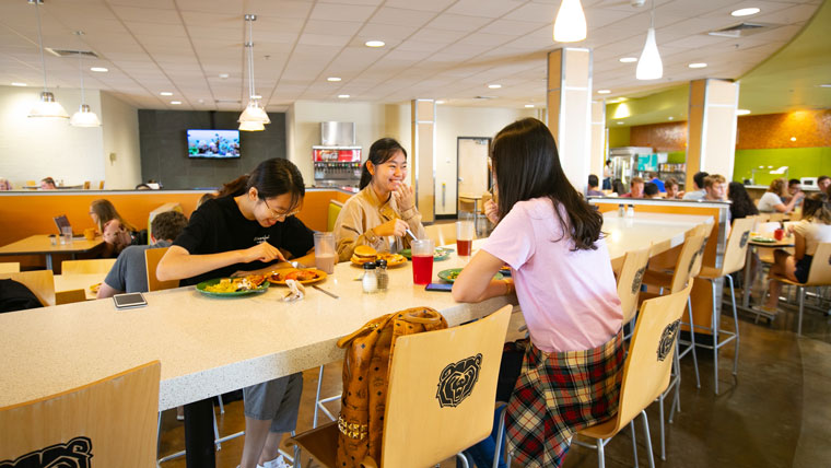 Students gather to eat in dining hall