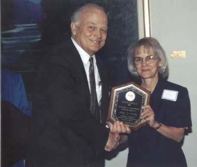 The first Faculty Advisor Award is presented to Susan Hom by President Keiser in April 1998.