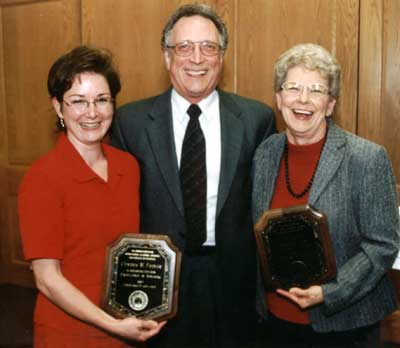 Staff recipient Cindy Fiedler and faculty recipient J.B. Petty with Dean Lawrence