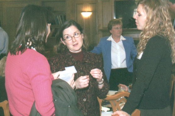 Cindy Fiedler and Amy Marie Aufdembring chatting with some friends