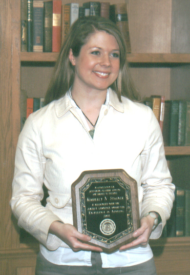 Kimberly Stagner with her award plaque