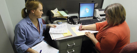Two ladies filling out papers