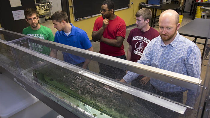 Students working with the flume