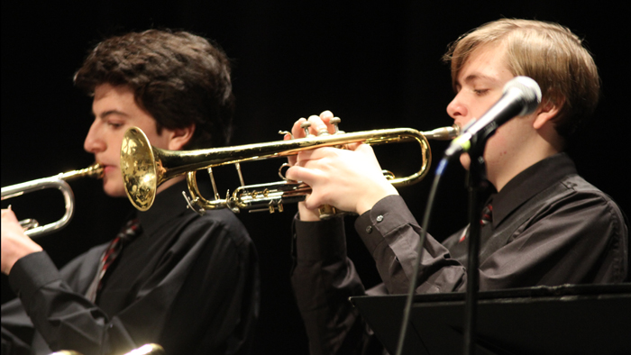 Two students performing in a jazz ensemble