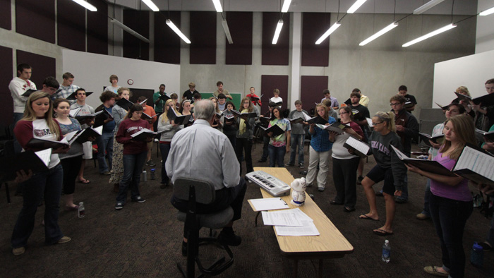 Teacher leading choral rehearsal