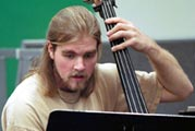 Student playing bass viol